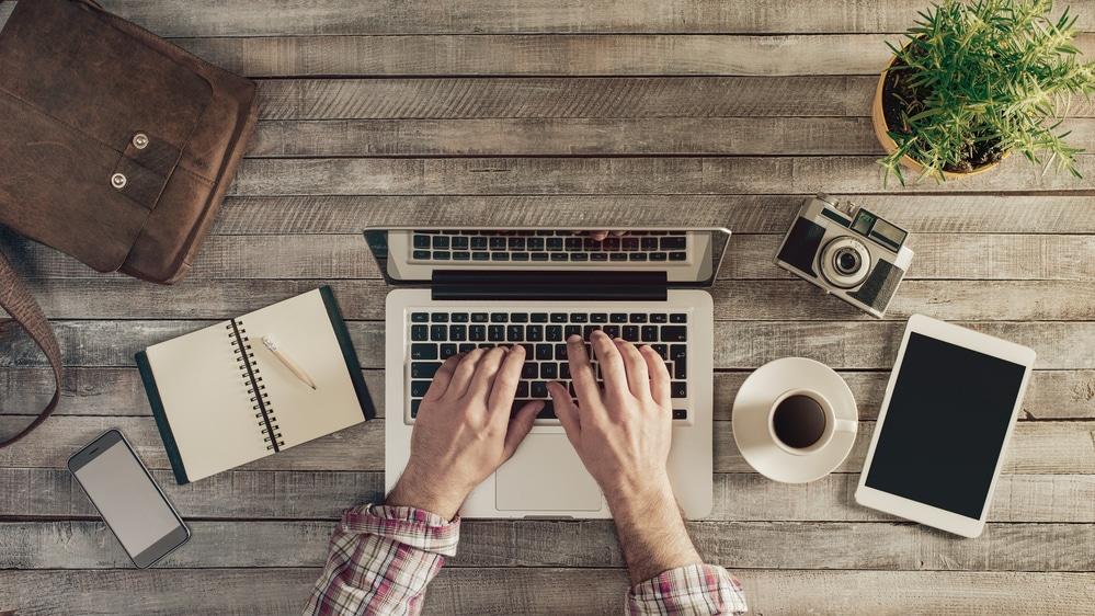 man working on his blog adding affiliate marketing